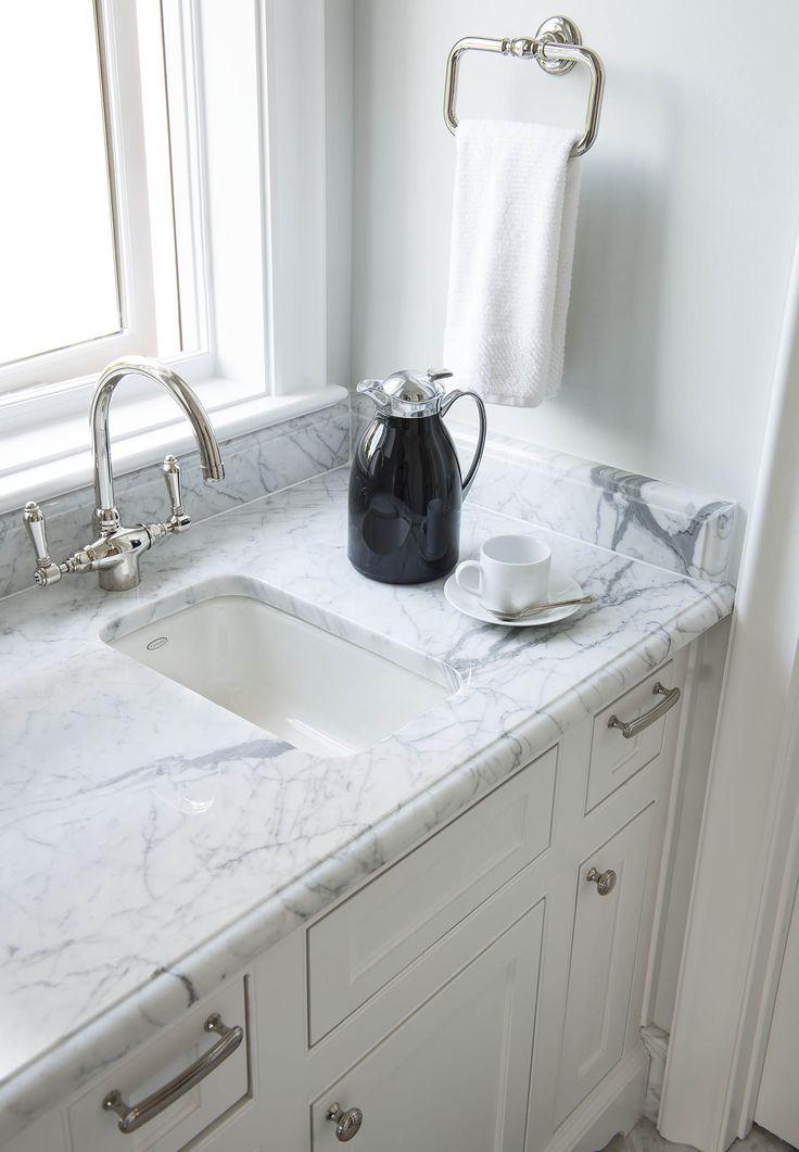 Designed by Denise McGaha Interiors. Photographed by Dan Piassick. #dallas #texas #design #interiordesign #marble #sink #bar #countertop #towel #coffee #window #light #bright #hardware