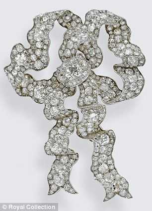 The Lover's Knot Brooch, left, was worn by the Queen at Prince William's wedding on 29 April 2011.