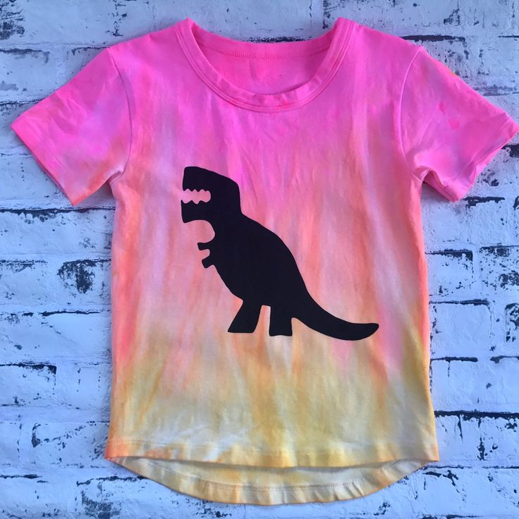 Made for those of you who aren't afraid of colour, these tees are unisex and on premium stock.  They come in three amazing colour schemes, Sunrise, Hyper Bomb and Ocean. Each one is hand dyed by me, making it individual and unique just like your roarsome kid!  Hand dyed and screen printed trex shirt for kids!