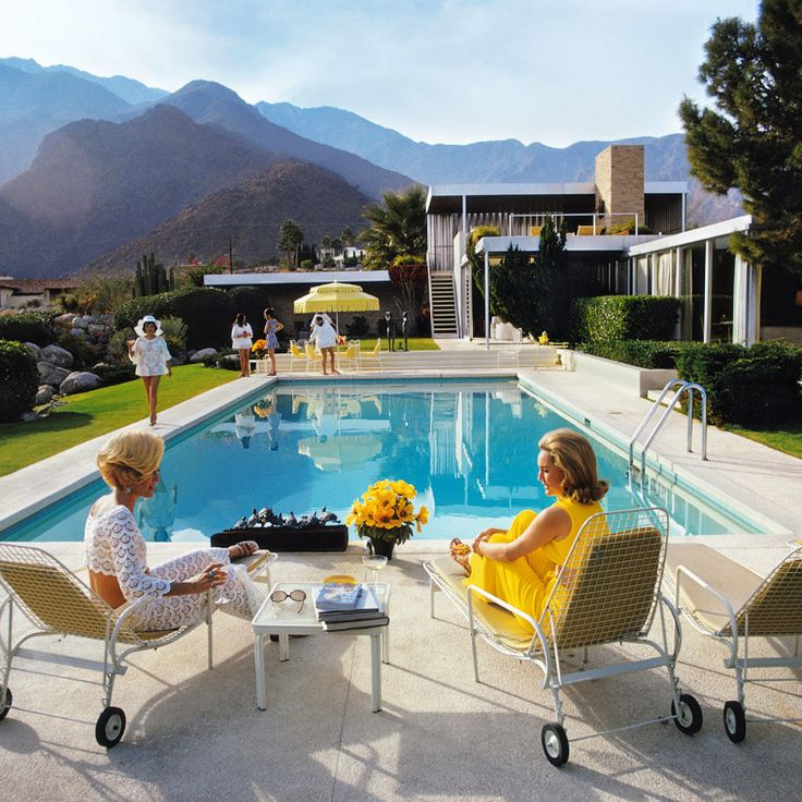 Slim Aarons's Poolside Gossip, 1970, featuring Palm Springs social doyennes Helen Kaptur and Nelda Links (from left). Courtesy of Slim Aarons/Getty Images.-Wmag