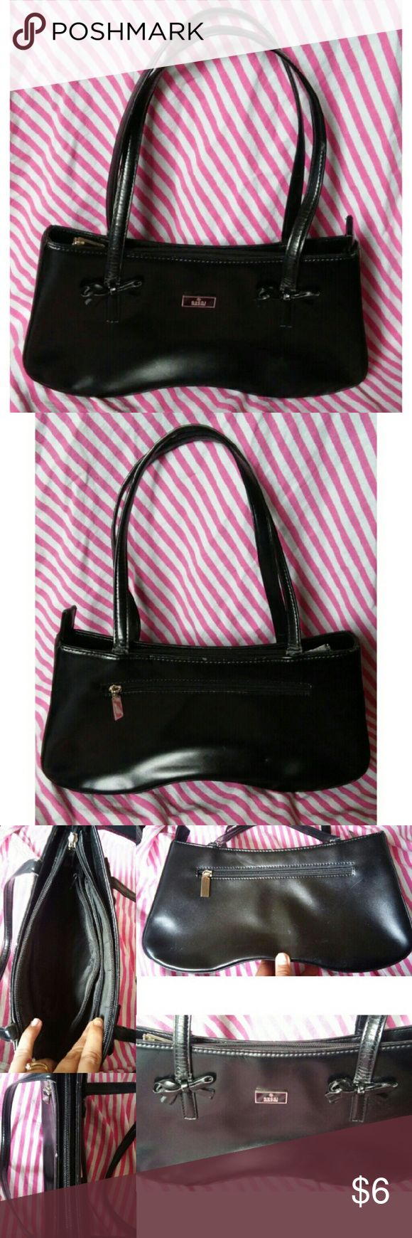 Black Replica handbag with bows Replica handbag  Black with bows  THIS BAG IS NOT REAL! REPEAT FAKE! THE BAG IS FAKE!  it is an inspired Gucci handbag  There are knicks, scuffs which are pictured.  The straps are wearing harshly.  I tried to picture all the flaws to give a better idea of condition of bag.  The interior is in good condition, lots of storage room for the size of the bag. Bags Shoulder Bags