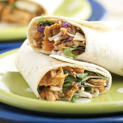 Asian Chicken Wraps: 2 boneless, skinless chicken breasts, cooked and shredded 2/3 cup General Tso's sauce 1/4 cup teriyaki sauce 4 10-inch flour tortillas 10-oz. pkg. romaine and cabbage salad mix 1/2 cup carrot, peeled and shredded 1/4 cup sliced almonds 2 tablespoons chow mein noodles