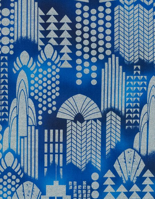 This luxurious fabric features silver metallic art deco style skyscrapers on a beautiful cobalt blue background. From Timeless Treasures. 100%