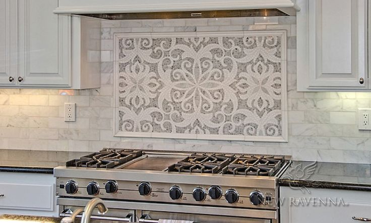 This custom Arabella mosaic backsplash is shown in polished Carrara and Thassos and is part of the Silk Road Collection by Sara Baldwin for New Ravenna.<br /> -photo courtesy of  Da Vinci Marble<br /> <br /> For pricing samples and design help, click here: http://www.newravenna.com/showrooms/