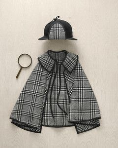 The detective and his trusty hound follow the scent to the next crime scene. Their matching plaid capes (modeled after the attire of Sherlock Holmes) are sewn from inexpensive suiting fabric with a simple pattern. Earflaps made from cloth and bias tape transform a pair of black baseball caps into a deerstalker hat.