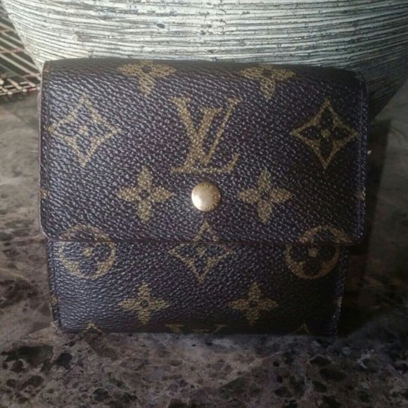 Louis Vuitton Elise Wallet Authentic Louis Vuitton wallet. Wallet is preowned. Shows some wear in one corner (pls see last photo). Also has a compartment for coins. Clean inside/out. Price is firm due to Posh's fee. Still a great buy! Louis Vuitton Bags Wallets