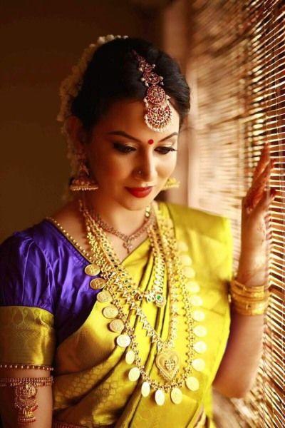 South Indian Hair and Makeup - Bride in a Yellow Kanjivaram Saree with a Blue Blouse and Gold Jewelry | WedMeGood | Makeup by Anurita Chandrappa #wedmegood #indianbride #southindianbride #southindianwedding #kanjivaram #yellow #goldjewlery