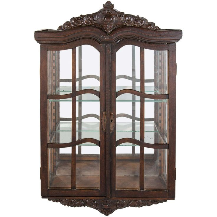 For Sale on - Beautiful antique wall mounted curio cabinet and vitrine in  dark wood with hand-carved crown moldings and pediments. Cabinet has  mirrored back ... - 16 Best Wall Decorations Images On Pinterest Wall Decor, Wall