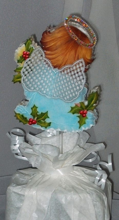 The cute angel from the back, with her wings.  My first serious attempt at hair painting, now part of a Christmas table decoration gift.