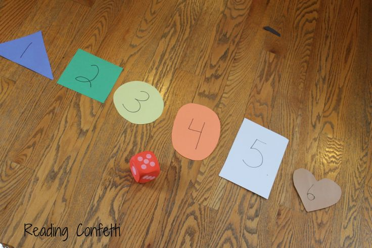 5 simple games for teaching number recognition to preschoolers.  Child rolls the dice, then stands at the correct numeral card - could make this whole group and whole body outside by spreading the numbers far apart and having kids run to them.