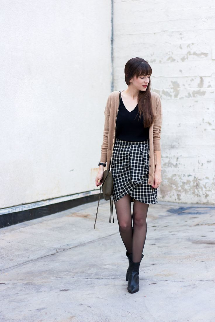 Camel Boyfriend Cardigan, Merino v neck sweater, plaid skirt and sheer black tights.