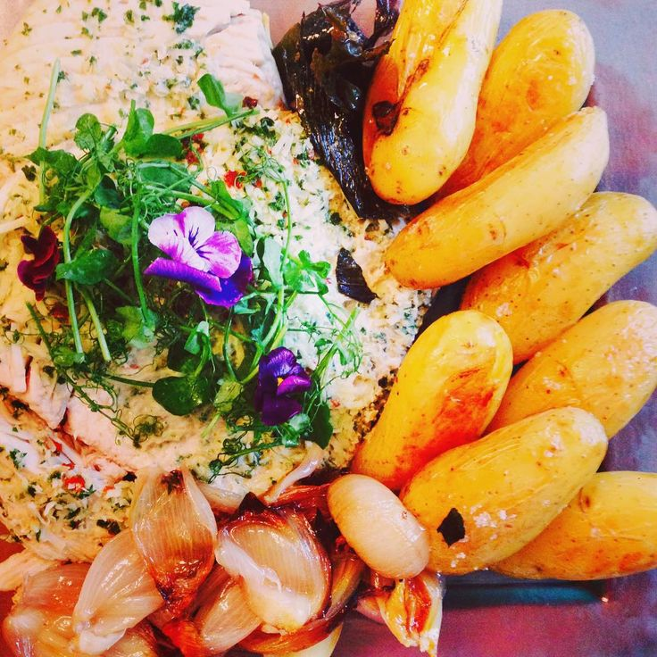 A family shared platter of coconut roasted fish; perla potatos; caramelised shallots and a curry sauce #feedingmyfamily #yummyinmytummy #kitchenswithoutboundaries #curry