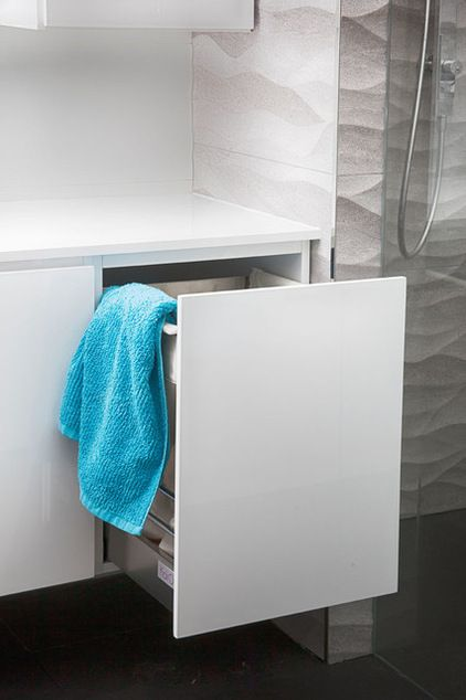 A hideaway hamper that looks like an ordinary drawer or cupboard is another neat idea that will enhance the look and functionality of your bathroom, as it will free up floor space and hide your dirty laundry.