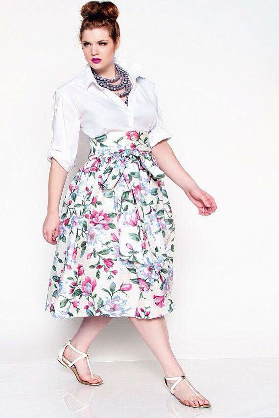 Tuck a white shirt into a waist high skirt with a thick came to accentuate the narrow waist. Elegant!