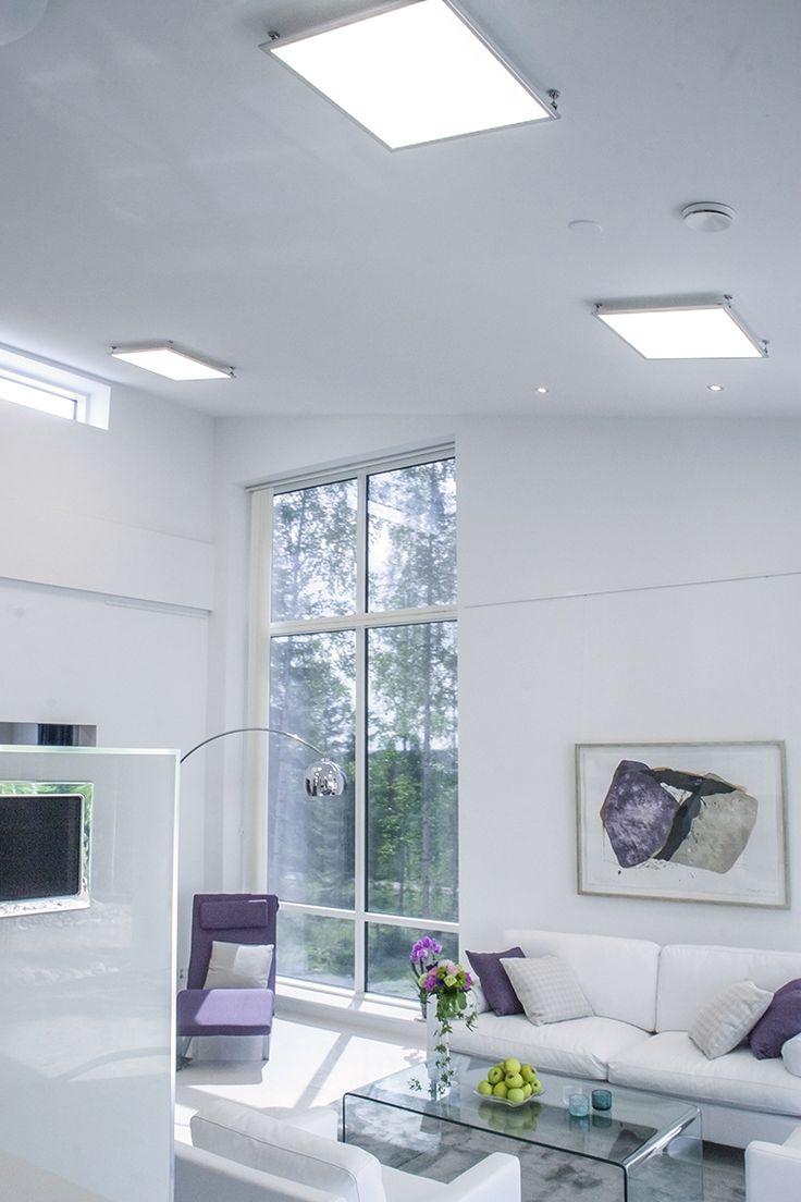 Cozy and light livingroom - Give the space fine glow with Eden LED-panels! Eden LED-paneelilla tasainen ja valoisa olohuone.