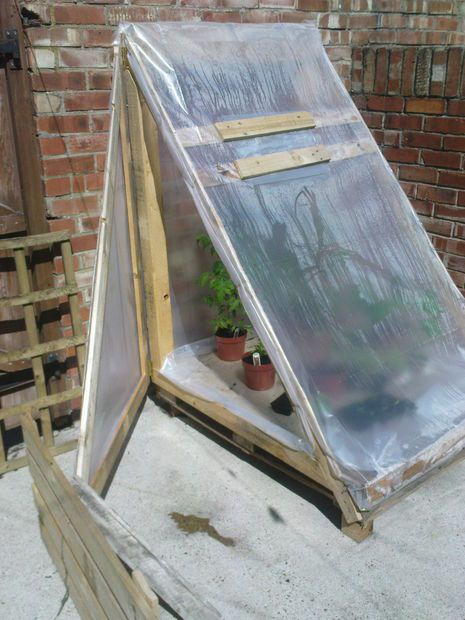 Greenhouse from pallet, some flat lumber & plastic sheeting. Drill...hammer/nails... staple gun. This one, I could probly pull off!