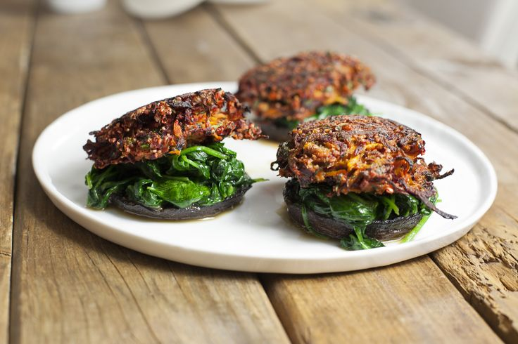 Beetroot and carrot burgers on wilted spinach and roasted portobellos ...