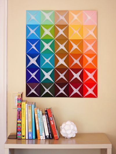 easy peasy, can be an easy art project for a child to keep busy for an hour or so xD  Make This: Folded Paper Wall Art