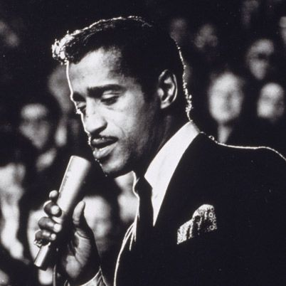 Born on December 8, 1925, in New York City, Sammy Davis Jr. overcame prevailing racism to become an entertaining legend. As part of the Rat Pack, with Frank Sinatra and Dean Martin, Davis was known for his films and his partying ways.