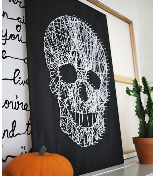 This intricate-looking string art project is actually surprisingly simple to pull off, and costs next to nothing to make.  Get the tutorial at A Beautiful Mess.   - CountryLiving.com