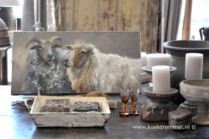 schilderij met een ooi en een ram