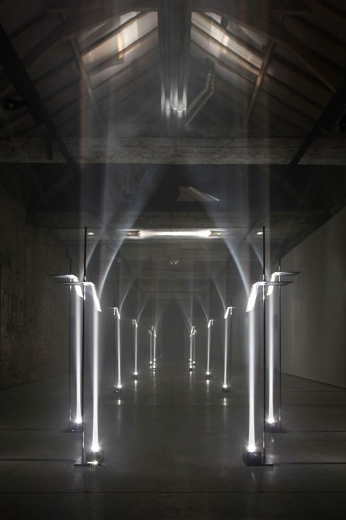 Incredible studio installation  Troika  in which a powerful light sources and lenses, transformed an old barn into a magical light arch, reminiscent Gothic.