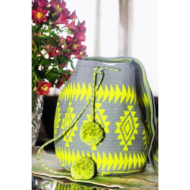 Wayuu Mochila bag Yellow and grey Harmony and rhythm join together creating a pattern. These patterns are filled…