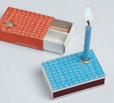 This matchbox has everything (almost) for a celebration, four candles, matches and a candleholder.