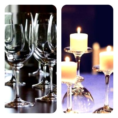Upside down wine glasses with candle on top. For me: 3 glasses per table, 15 total tables, so 45 wine glasses and candles. Where to find bulk inexpensive wine glasses...
