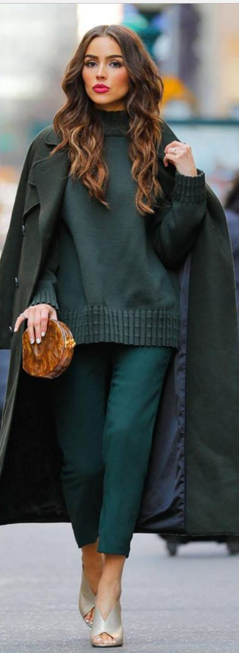 Who made Olivia Culpo's green coat, crop pants, turtleneck sweater, brown clutch handbag, and tan sandals?