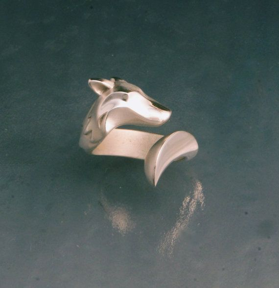 i cant believe its taken this long but here-- finally --is a wolf ring in sterling silver. a bit more detail , like the furred ruff of the neck and