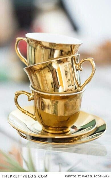 Gold tea cups and saucers