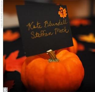 mini pumpkins as place card holders