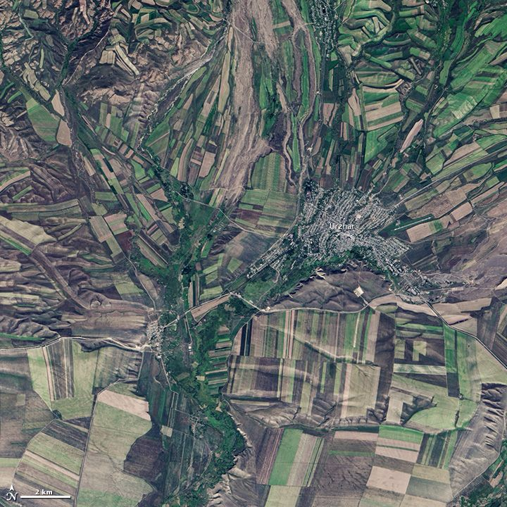 September 22, the autumnal equinox, marks the beginning of fall in the Northern Hemisphere, but the fall harvest begins early in the harsh continental climate of eastern Kazakhstan. By September 9, 2013, when the Operational Land Imager (OLI) on the Landsat 8 satellite acquired this image, several fields were already harvested and bare. Others were dark green with pasture grasses or ripening crops.