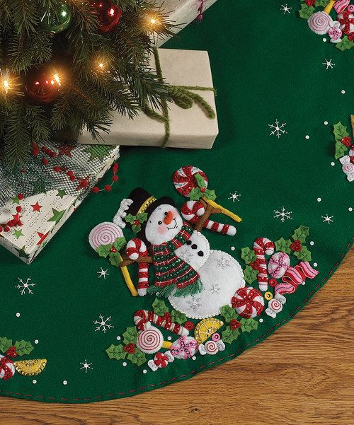 Dress up the tree and provide a soft landing spot for presents with the handmade tree skirt crafted from this kit. Form meets function as this piece protects floors and adds a cheery homemade touch to seasonal décor.Includes felt, sequins, beads, embroidery floss, needles and instructions43'' diameterFeltSpot cleanMade in the USA