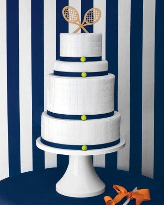 Topped with mini rackets, the four-tiered red-velvet cake was iced with fondant that was hand-embossed to resemble a tennis net.