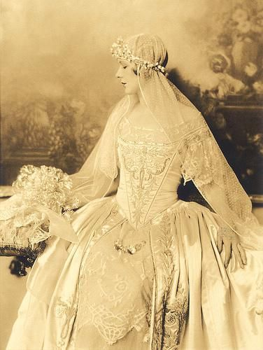1920s bride. She must have had a love of the old world. Just look at that dress!