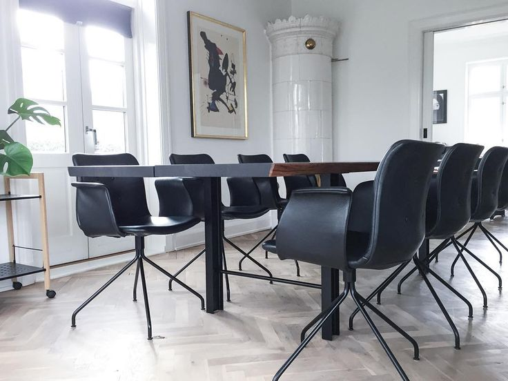 Primum dining chairs in black leather and the dining table Track in smoked oak.
