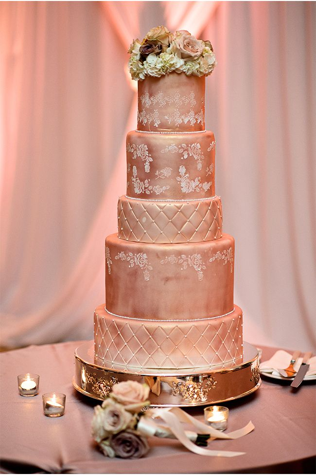 rose gold wedding cake with flowers gold wedding cake kristen weaver photography 19299