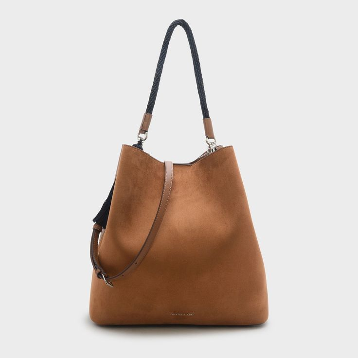 CHARLES & KEITH - Bags. Camel slouchy shoulder bag featuring a top handle and tassel details. Comes with an additional inner pouch.