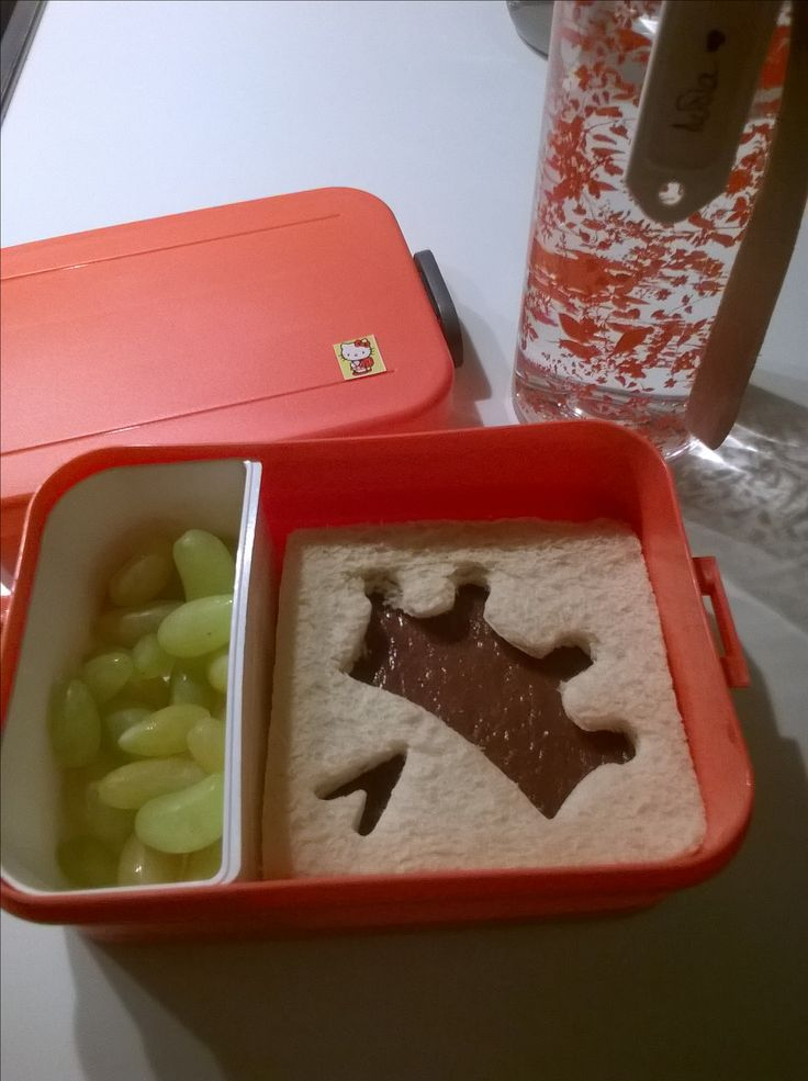 Snack for school .Toast with cocoa sesame paste and grapes .