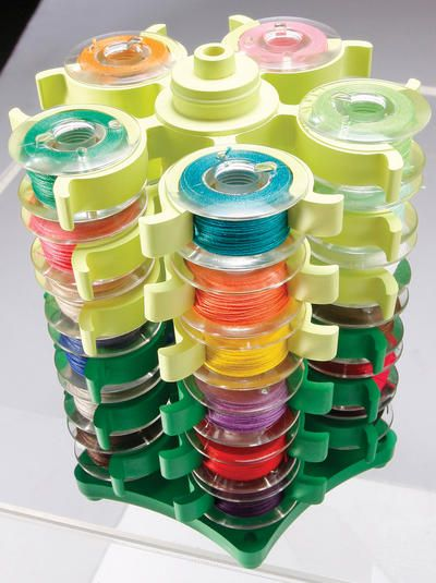 Stack 'n Store Bobbin Tower. Neatly organize your bobbins with this handy little tower. Each level holds five bobbins of just about any size securely with out you needing to tape your ends. #sewing $13.56