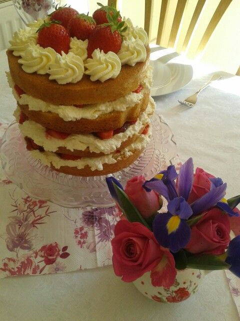 Victoria sandwich with fresh cream and strawberries