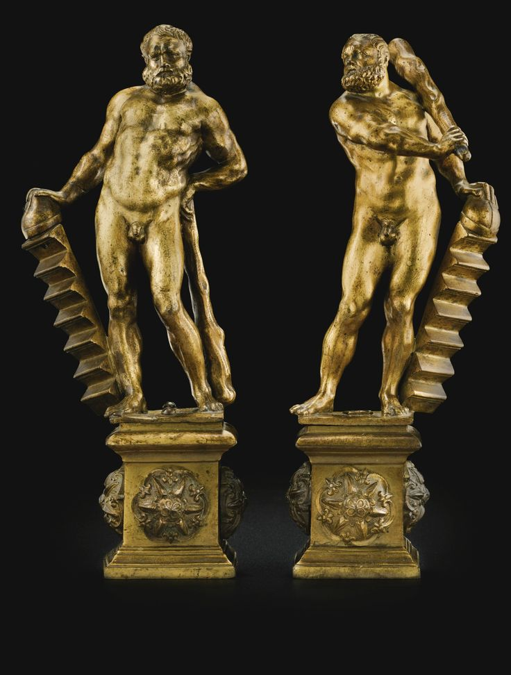 'PAIR OF BRONZES REPRESENTING HERCULES CARRYING THE GRADENIGO FAMILY STEPS'. ITALIAN, VENICE, CIRCA 1570. One with a remnant of a wax seal on the underside. Gilt bronze. 30.5 cm., 12 in. and 29.5 cm., 11 5/8 in. The present representations of Hercules lean on a set of steps surmounted by a Doge's hat, which are the attributes of the Gradenigo family of Venice. The family played a key part in the leadership of the city state from the Middle Ages onwards, providing numerous Doges. -Sotheby's-
