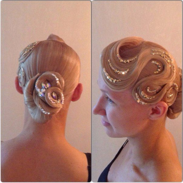 Low swirl bun with a large bang swoop and rhinestone accents. Good hairstyle for latin and standard ballroom. Visit http://ballroomguide.com/comp/hair_make_up.html for more hair and makeup info