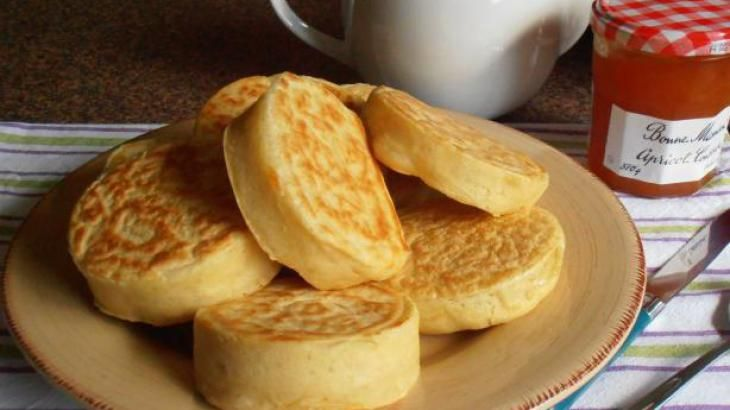 Old Fashioned Home-Made English Crumpets for Tea-Time Recipe --- A crumpet is a griddle cake made from flour and yeast. Crumpets may have been an Anglo-Saxon invention. In early times, they were hard pancakes cooked on a griddle, rather than the soft and spongy crumpets of the Victorian era