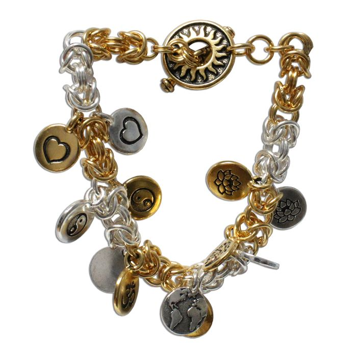 Charms In Harmony Bracelet is a gold and silver chainmail bracelet with a decorative pewter clasp. The theme of this charm bracelet is harmony. The plated brass chainmail and pewter charms give this bracelet considerable weight and substance. The gold and silver of the charms and the Byzantine segments are placed to balance and complement each other. The charms selected for this bracelet symbolize harmony within ourselves, with each other, and with the earth.