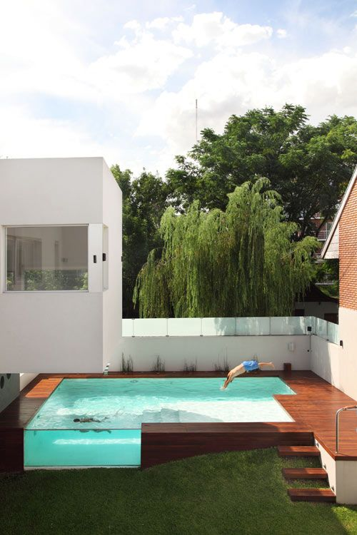 Located in Argentina, this 500m2 home by Andrés Remy Arquitectos was created for a young family who wanted to feel close to nature in an urban environment.