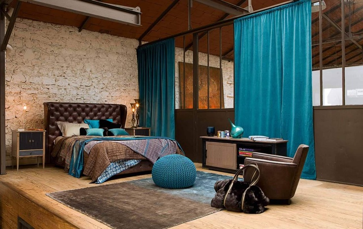 Loft bedroom with brown and turquoise