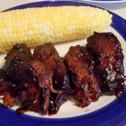 A set-it, then forget-it type recipe for your slow cooker yields tender, barbecue-flavored country pork ribs that are ready when you are. Barbecue sauce and orange juice add their sweet and tangy flavors. Just throw together a side dish or two and you're done.